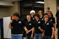 Extra-crurricular music groups such as Acafellas perform festive tunes for their peers and parents at Jingle bell Java.