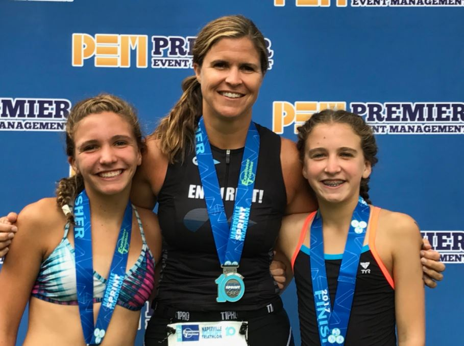 """The Brunses competed in the Naperville Sprint Triathlon in August.  """"It was a pretty cool moment when Lindsey, Molly and I each took first place in our Age Groups at the Naperville Sprint Triathlon and got to take turns standing at the top of the podium,"""" Betsy said."""
