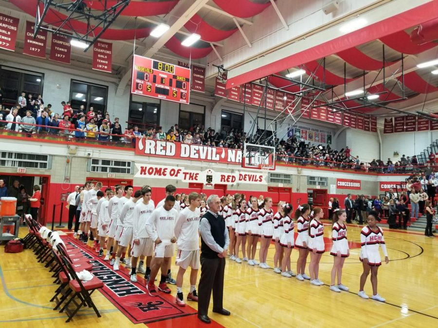 The+boys+basketball+team+stands+for+the+National+Anthem+at+home+prior+to+the+tip-off+against+York+on+Friday%2C+Jan.+12.