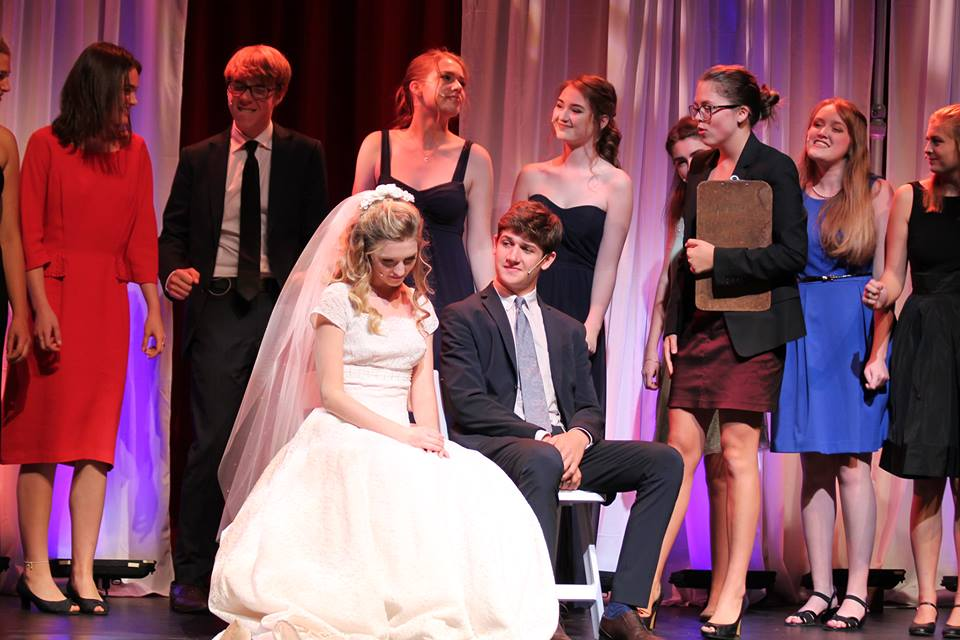 In addition to acting in this year's September Show, junior Tim Moser, seated right, will be acting as Jean-Michel in