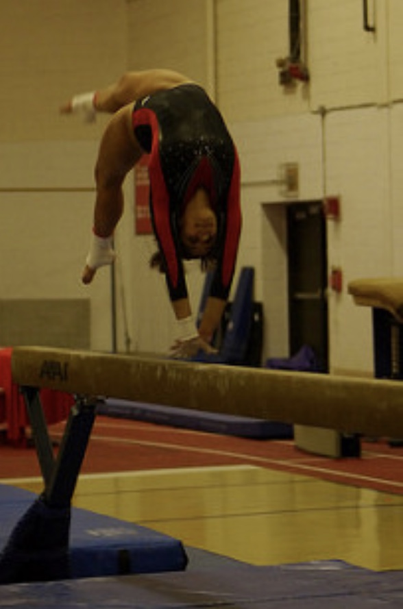 Amanda Leon, senior, competes on the beam at the varsity Regionals meet.
