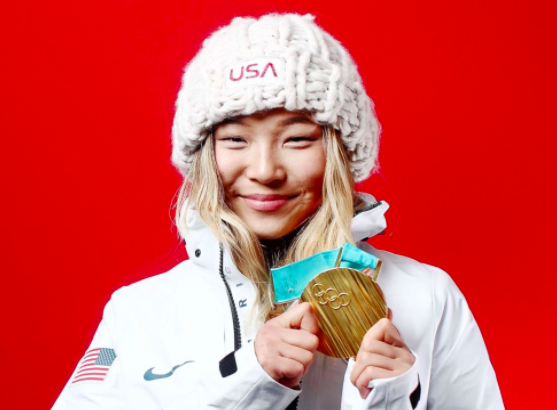 Chloe Kim poses after winning the gold for Women's Halfpipe.