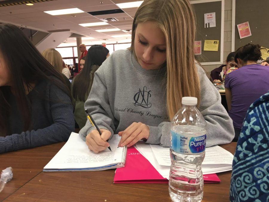 Sophomore, Aly Koranda, attempts to get some last minute studying in at lunch before her American politics test.