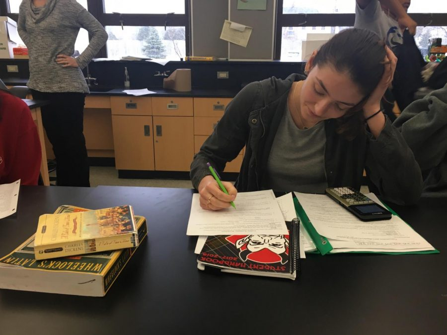 Mia Gaddis, sophomore, works through a worksheet of chemistry problems during class.