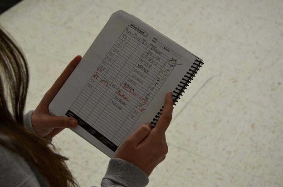 Teachers give out passes by signing students' planners in a section titled