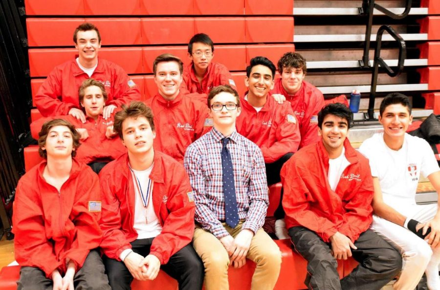The boys gymnastics team poses at the Red vs. White meet on Feb. 23.