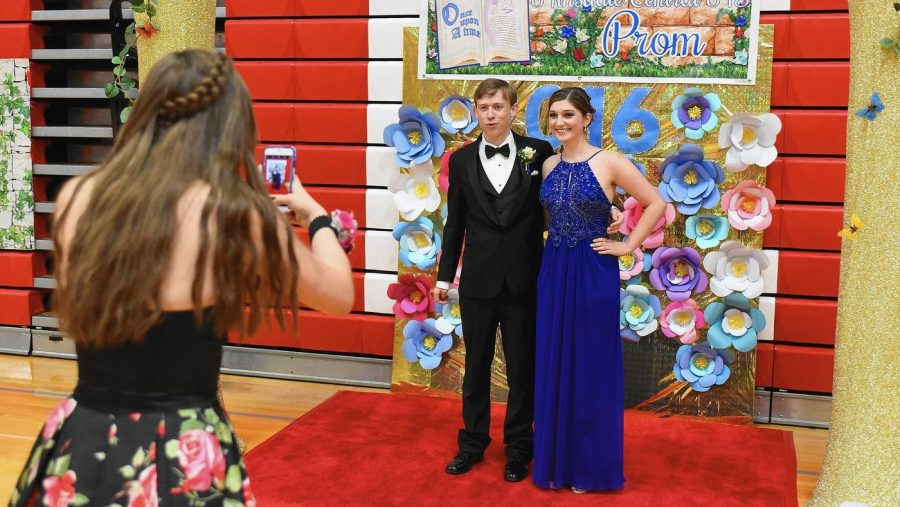 A couple poses for a picture in their prom attire at Hinsdale Central's prom in 2016.