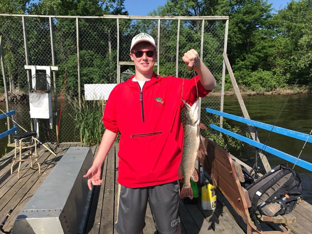 Joey Kolnicki, junior, shows off a six-pound bass.