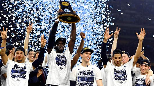Villanova team members raise their third National Championship trophy in three years.