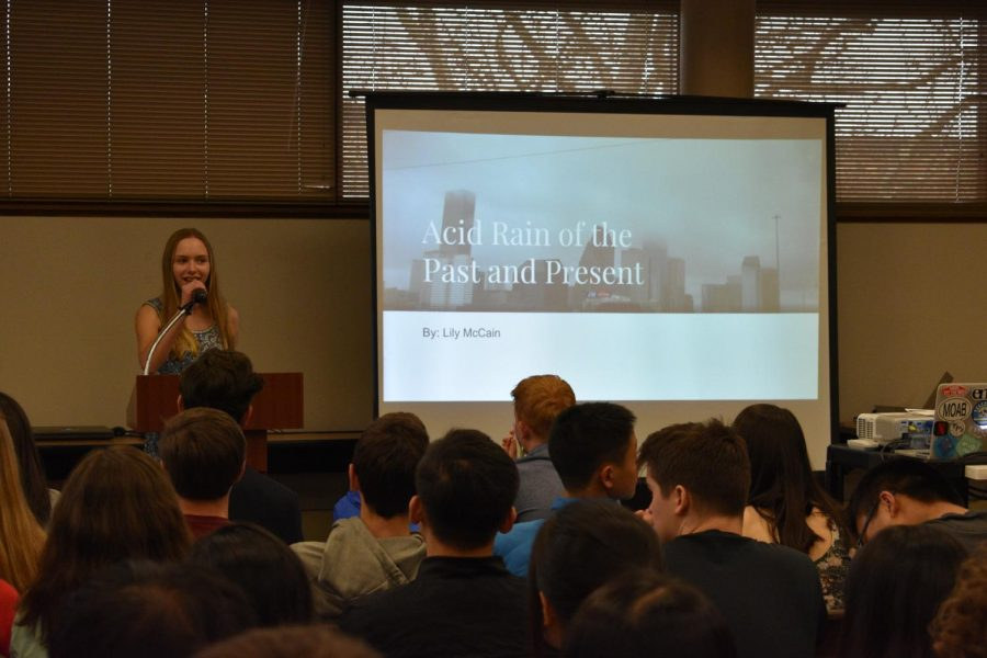 Lily McCain, freshman, presents to students and faculty at the annual earth science symposium.