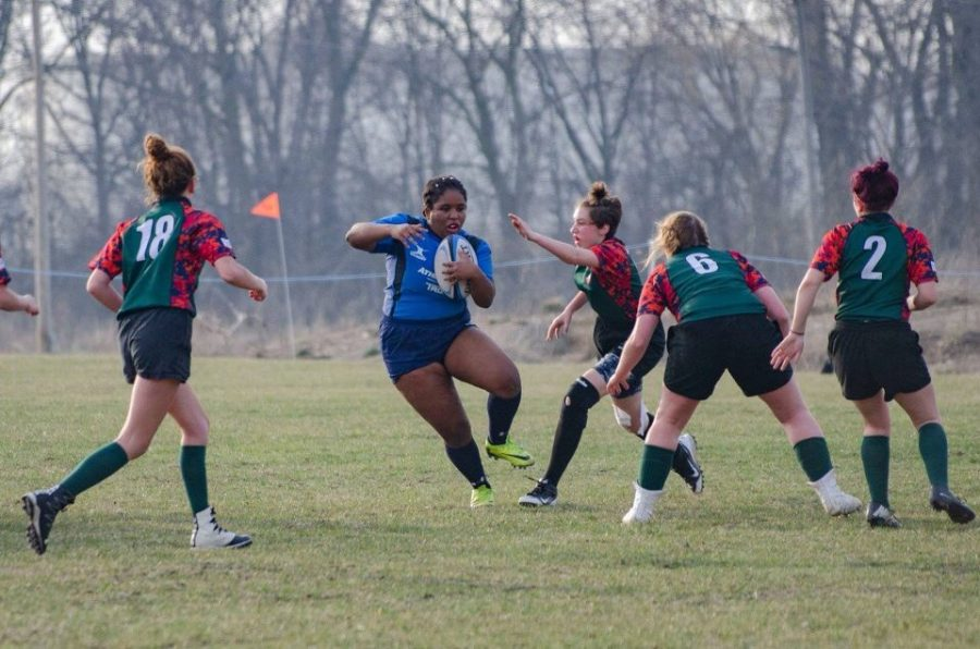 A West Suburban Bulls High School Rugby Club player shuffles over to avoid a tackle.