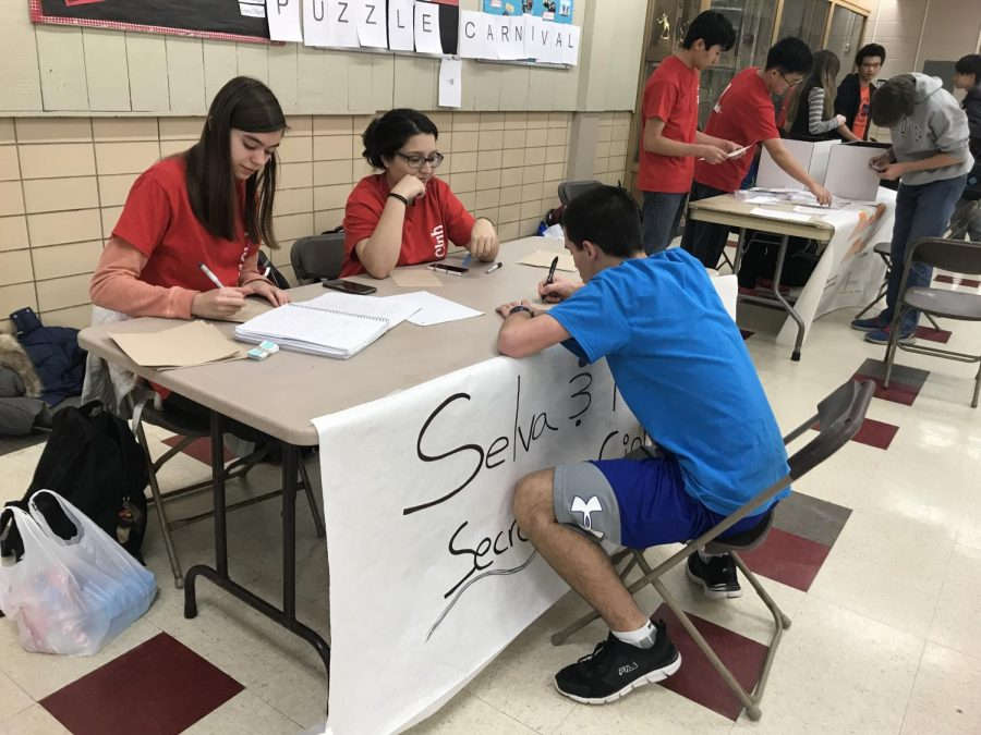 Puzzle Club, a relatively new club started by Michael Hu, junior, encourages students to think creatively while letting off some steam solving puzzles. Here, a student is being taught how to solve cipher puzzles at Puzzle Club's carnival on Wednesday, March 21.