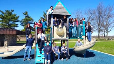 The Science Olympiad team poses in front of playground near the UIUC campus at the beginning of their weekend.