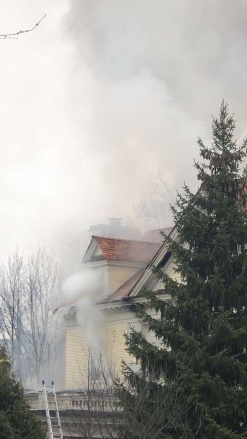 Smoke and fire was seen and smelled throughout the air. Firemen rushed outside of the burning house with the owners dog. Luckily, no one else was inside the house and no one was harmed in this fire.