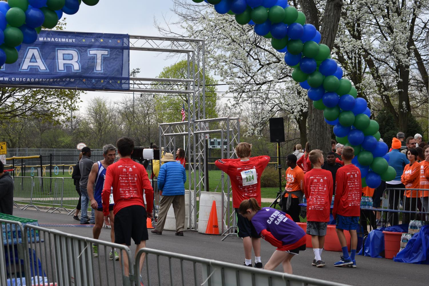 Runners stretch and warm up for the race they were going to participate in. The 5k runners and 3k walkers all lined up at 8:30 a.m. to begin the race.