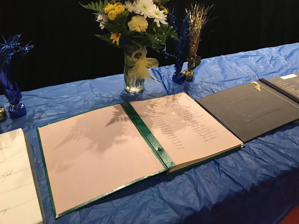 After being inducted into the National Honors Society on Thursday, April 26, inductees then carried out the tradition of signing their name in a book where all past RDN inductees have signed as well.