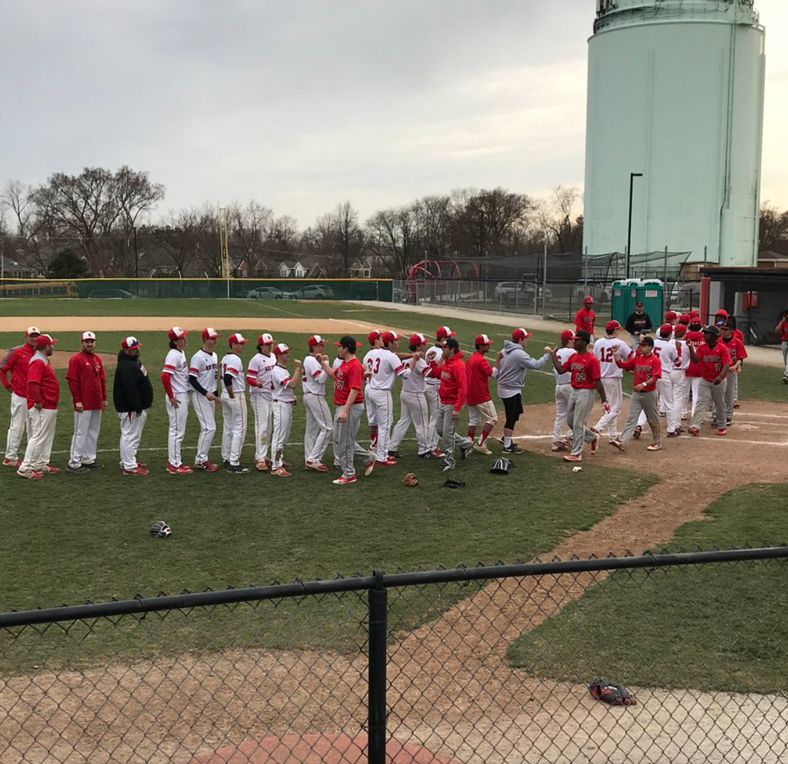 The team takes the field post-game to shake hands with their opponents on Monday, April 23.