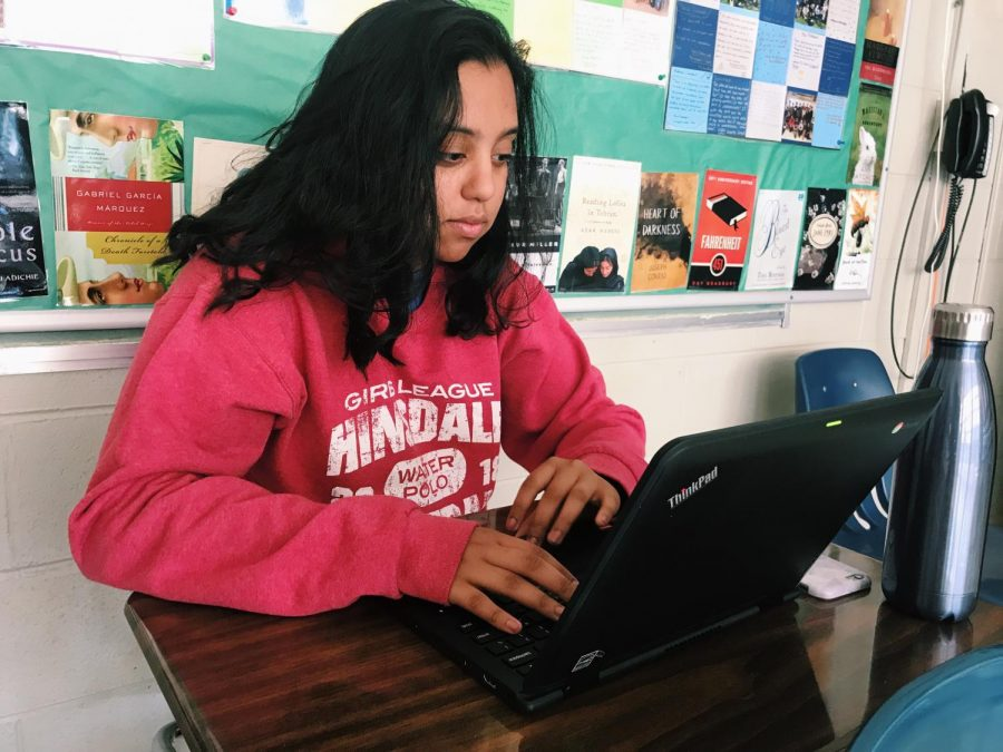 Junior, Aman Natt, works on the Chromebook in her AP Literature class to complete an in-class essay.