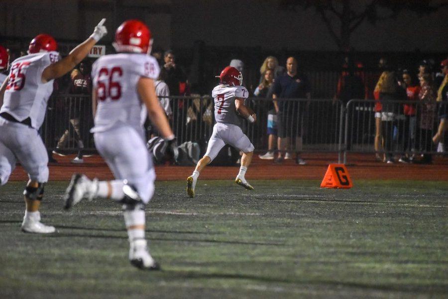 Luke Skokna, senior running back, races to the end zone for a touchdown.