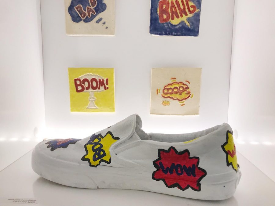 Marvel+themed+art+sound+effects+like+%27Wow%27+and+%27Boom%27+are+painted+onto+a+popular+style+of+shoes.+Sound+effects+helped+bring+the+art+to+life.
