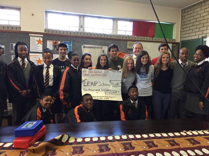 LEAP club presented African students and the founder of LEAP club with the money they gathered from fundraisers.