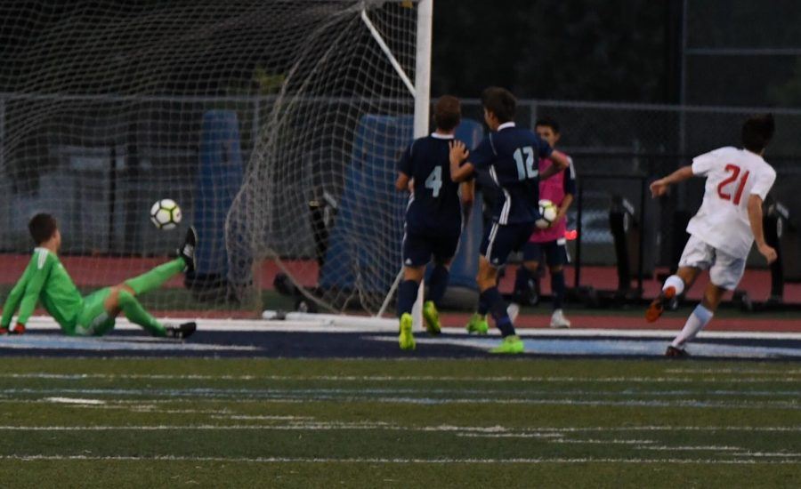 John Paul Lteif puts it into the back of the net during their game against Downers Grove South.