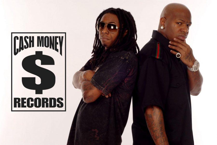 Lil Wayne( left) is posing alongside Cash Money Records CEO Birdman(right).