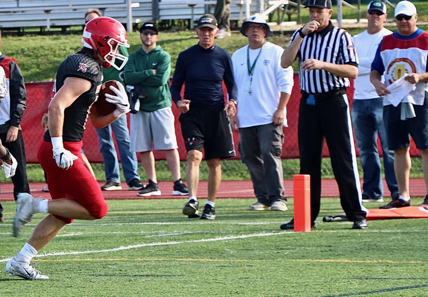 Nick Franko, junior, scored the first touchdown for the Red Devils making the score 21-7 in the fourth quarter.