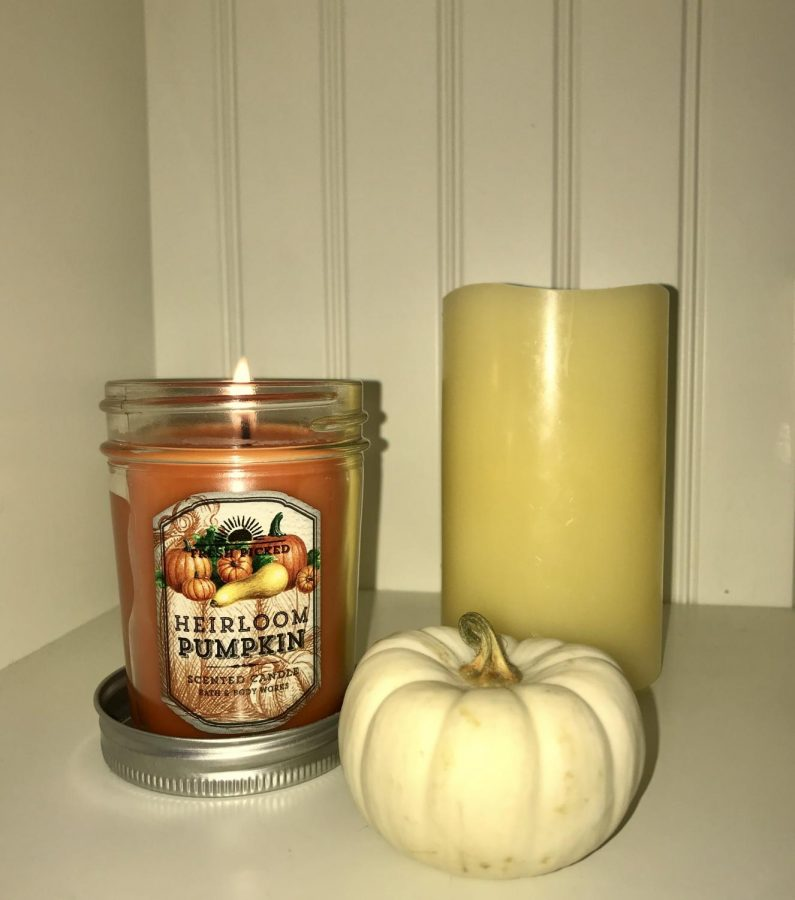 A+popular+way+to+get+in+the+autumn+mood+is+to+light+scented+candles%2C+such+as+this+%22Fresh+Picked+Heirloom+Pumpkin%22+candle+from+Bath+%26+Body+Works.
