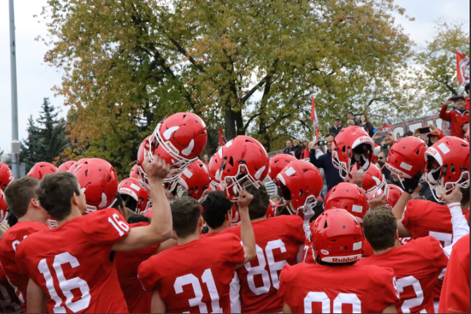 The football team celebrates after winning against Conant with a final score of 28-14.
