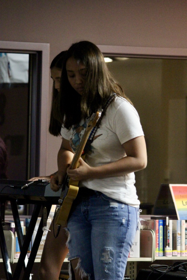 Senior Adele Ruby plays guitar for Planet Nine and takes part in the performances for school.