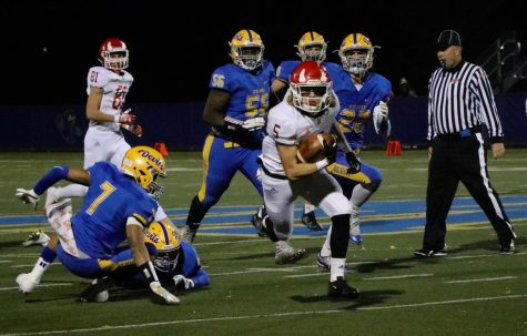 Red Devils lose football playoffs to Blue Devils