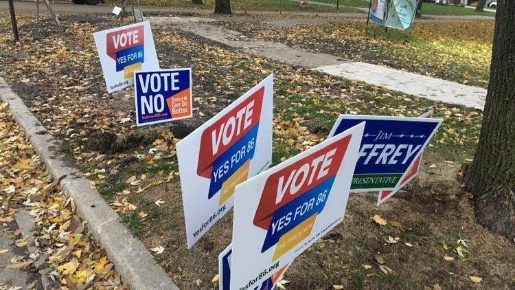 Campaigns signs for and against District 86s $166 million referendum.