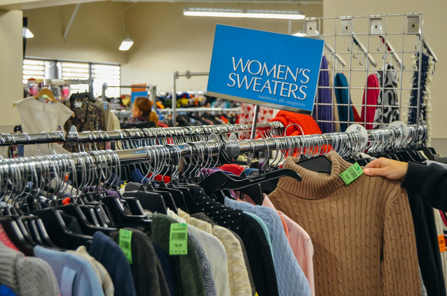 Goodwill, pictured above, has a location in Hinsdale with racks full of sweaters and long sleeve tops that are perfect for the colder weather.
