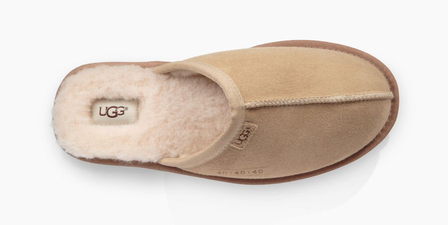 These Men's Ugg slip-ons are easy to put on and have a furry texture on the inside.