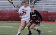 Sydney Collignon, senior midfielder, is about to charge up the middle and score a goal against the Rockford Rams.