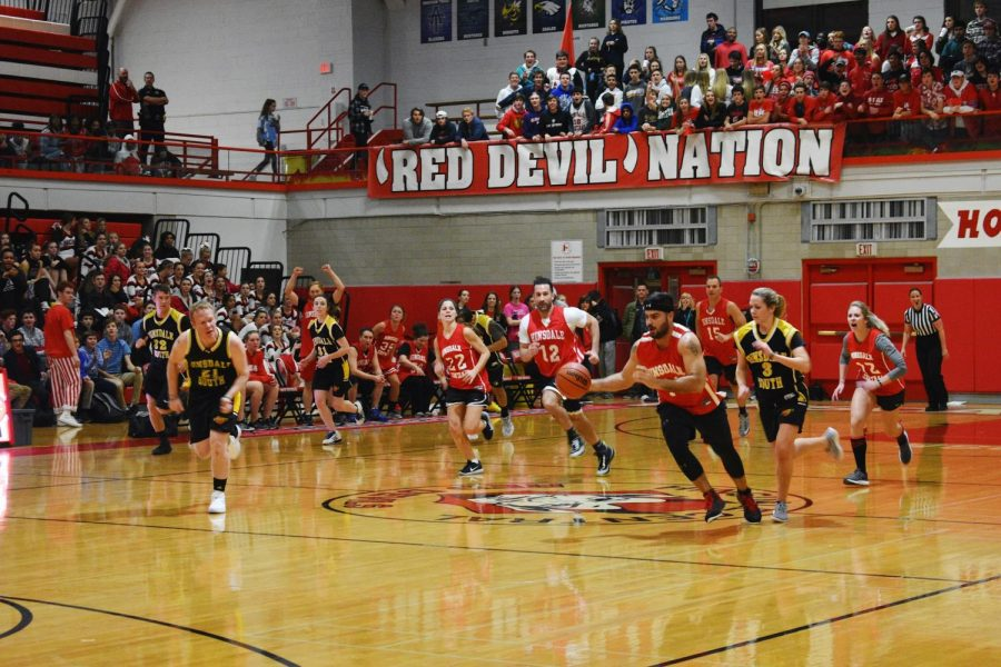 The staff faced the Hinsdale South team before the Boy's Varsity game. The Red Devils' unfortunately lost to the Hornets.