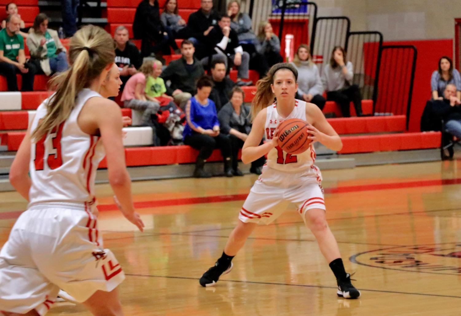 Madeline Bokich, senior, passes to her teammate Anna Howell, junior, during the game against York.