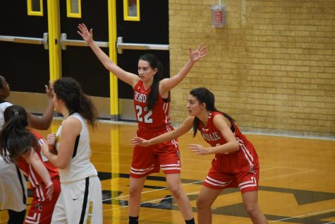 Sister Tina & Maria Rivera play defense during a varsity game.