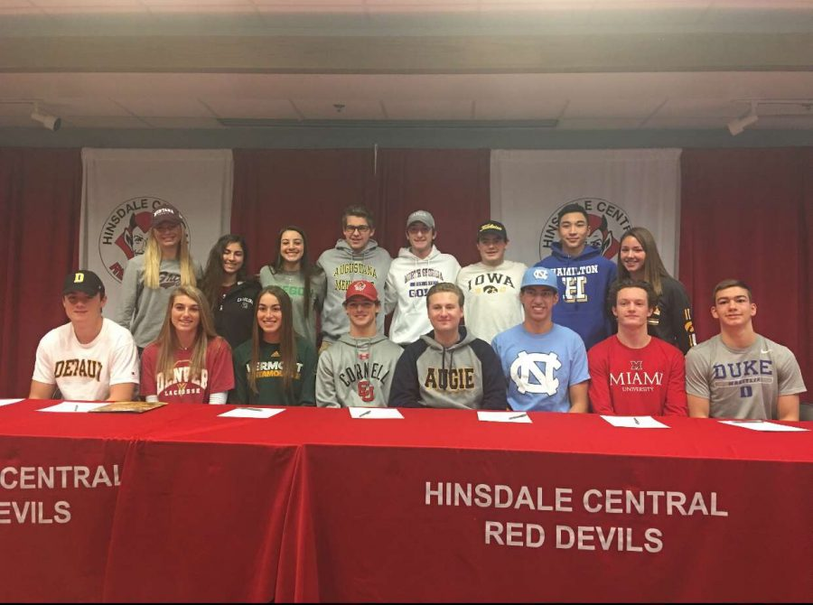All+16+of+the+committed+athletes+posed+in+their+respective+college+t-shirts+to+celebrate+their+signings.
