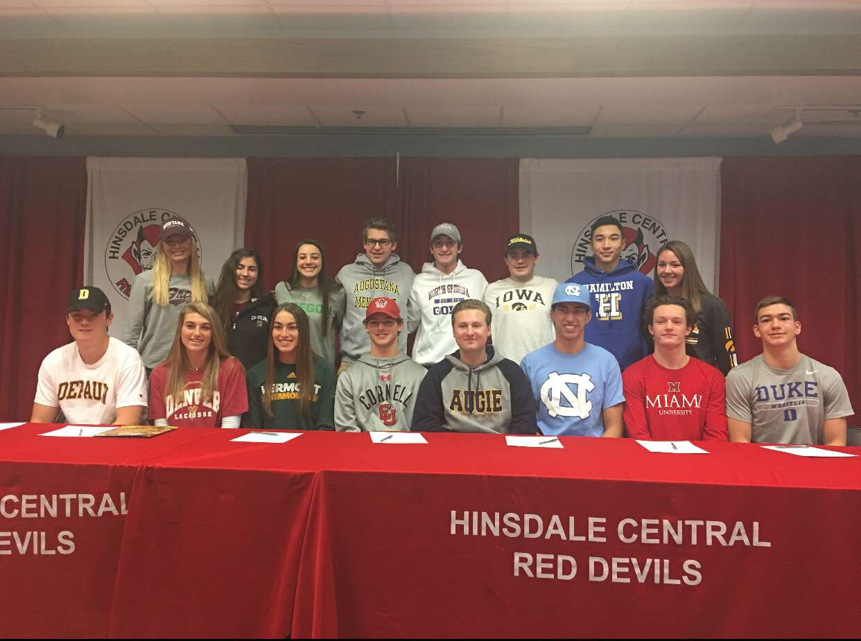 All 16 of the committed athletes posed in their respective college t-shirts to celebrate their signings.