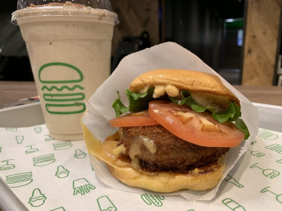 The Shroom burger consists of a crisp-fried portobello mushroom filled with melted muenster and cheddar cheeses, topped with lettuce, tomato, and ShackSauce.