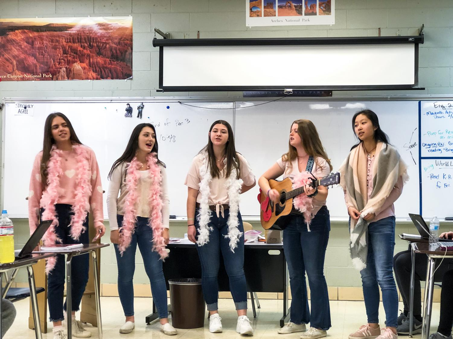 A group of senior girls perform singing valentines on Feb. 14.