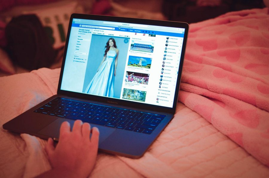 Even though prom is months away, students are already buying their dresses and organizing their table. Pictured above is a student scrolling through the 2019 Hinsdale Central Prom Dress Facebook group, which is dedicated to ensuring every girl has a different dress.