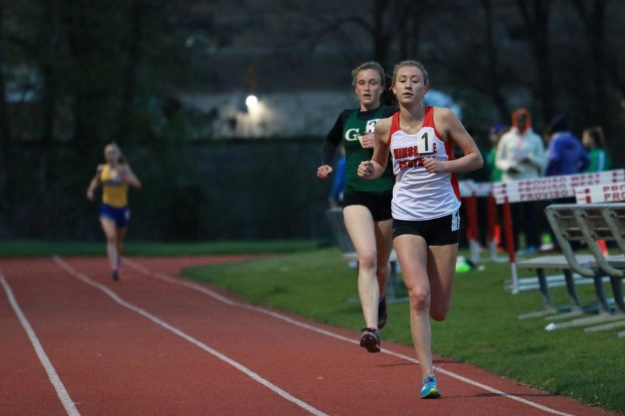 Mckenna+Revord%2C+junior%2C+leads+the+3200+meter+run+throughout+the+entire+race%2C+in+front+of+former+all+state+runners+Katie+Hohe+of+Glenbard+West%2C+and+Sarah+Barcelona+of+Lyons+Township.+