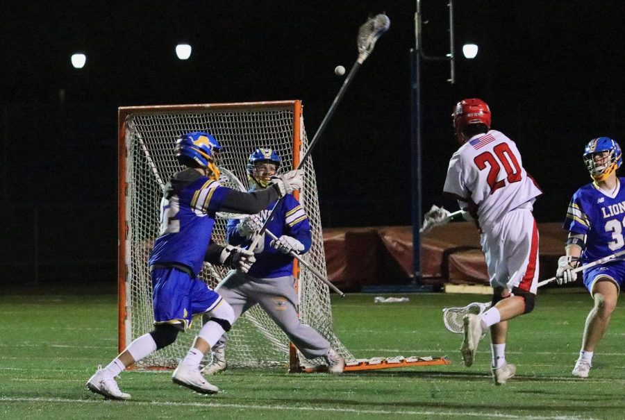 Parker Bailey, senior midfielder, scored against the Lyons Township High School Lions on Thursday, April 18 on Dickinson Field.