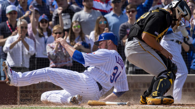 Apr 8, 2019; Chicago, IL, USA; Chicago Cubs starting pitcher Jon Lester (34) slides in to score during the second inning against the Pittsburgh Pirates at Wrigley Field. Mandatory Credit: Patrick Gorski-USA TODAY Sports