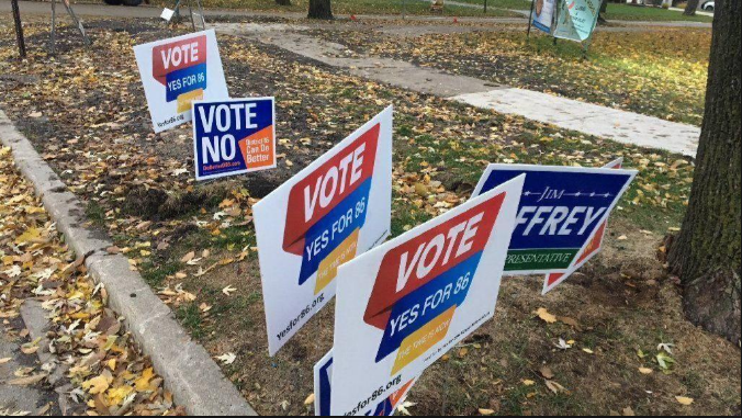 Signs from both Vote Yes and D86 Can do Better lines the sides of roads in the days leading up to the election.