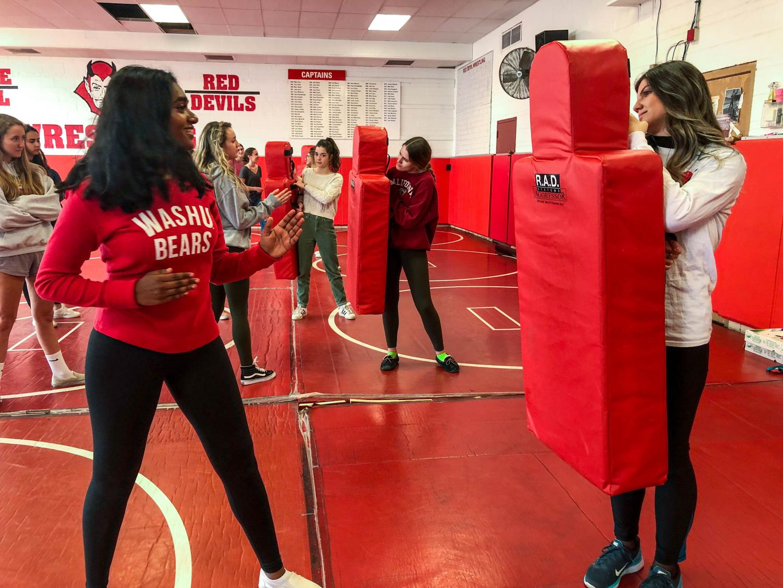 Harini Loganathan, senior, practiced her defensive stance against Jenni Stavreva, senior, her attacker for the simulation.