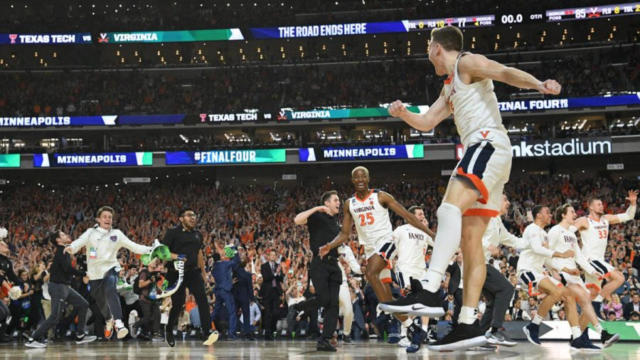 Moments after the games conclusion, Virginia players rush the court in celebration,